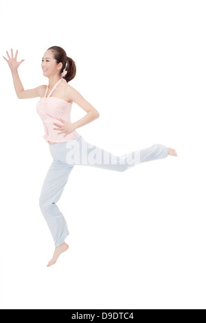 young woman dancing and jumping - Stock Photo