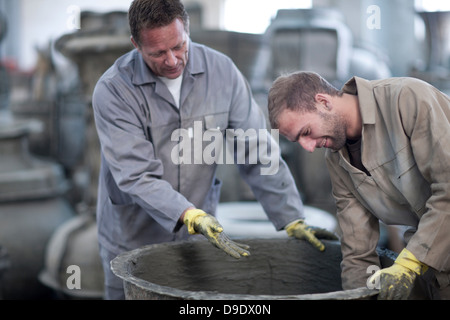 Preparing material for making pottery - Stock Photo