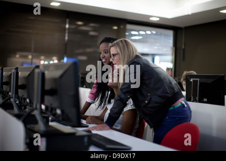 Students using computers in class - Stock Photo