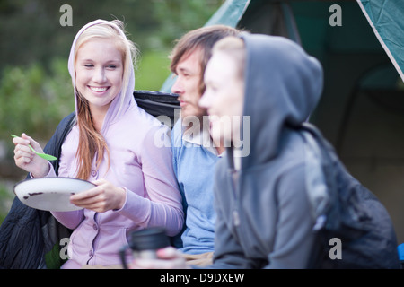 Group of young people camping - Stock Photo