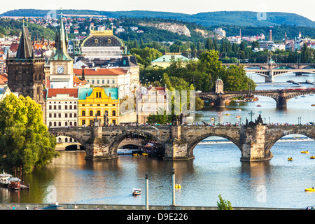 View of Prague and bridges over river Vltava (Moldau) Czech Republic. Famous Charles Bridge is in the foreground. - Stock Photo