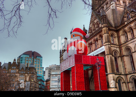 Manchester Town Hall decorated for festive season with a figure of Father Christmas. - Stock Photo