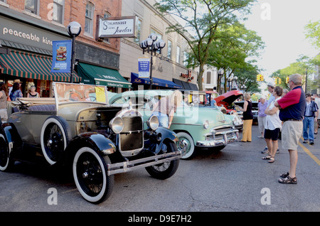 1928 Ford Model A and 1950 Chevrolet 2d Deluxe at the Rolling Sculpture car show July 13, 2012 in Ann Arbor, Michigan - Stock Photo