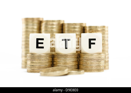 ETF (Exchange Traded Fund) on gold coins with white background - Stock Photo