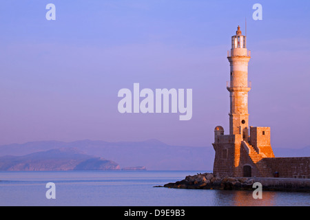 Chania's centuries-old lighthouse in Venetian Harbour in early morning - Stock Photo