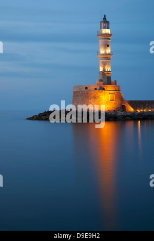 Chania's centuries old lighthouse in Venetian Harbour at twilight - Stock Photo