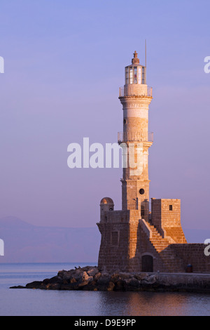 Venetian Harbour in early morning and Chania's centuries old lighthouse - Stock Photo