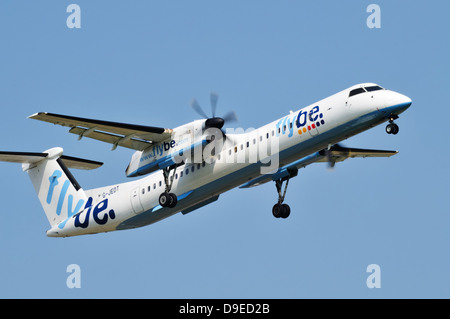 Flybe de Havilland DHC-8 dash 8 coming in to land with landing gear lowered - Stock Photo
