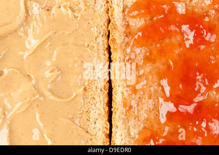Homemade Peanut Butter and Jelly Sandwich against a background - Stock Photo