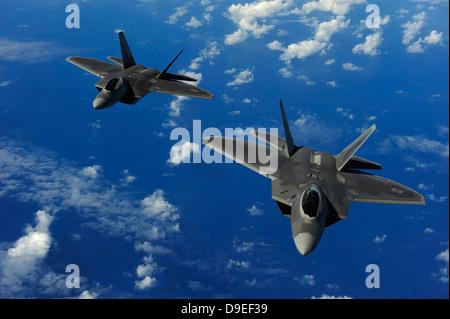 February 16, 2010 - U.S. Air Force F-22 Raptors in flight near Guam. - Stock Photo