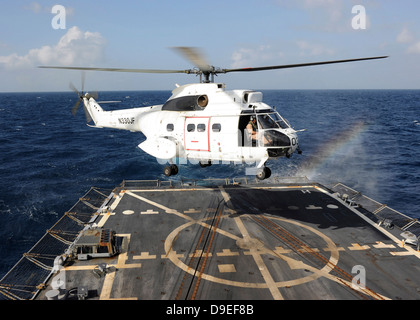 Helicopter lands aboard the Arleigh Burke-class guided-missile destroyer USS Farragut. - Stock Photo
