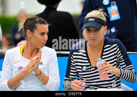 Flavia Pennetta (Italy)  and Elena Vesnina (Russia) playing doubles, sitting between games at Eastbourne, 2013 - Stock Photo