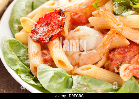 Homemade Shrimp Pasta with tomatoes and green spinach - Stock Photo