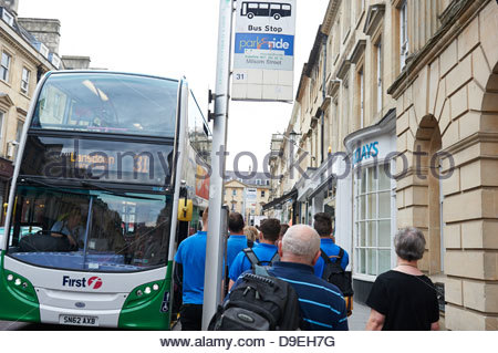 Bath in Somerset England UK tourist tourism park and ride bus Landsdown No 31 wait bus stop passengers wait board - Stock Photo