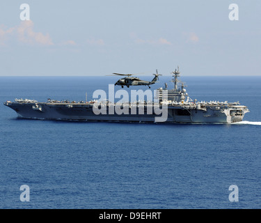 Atlantic Ocean, October 10, 2010 - An MH-60S Seahawk helicopter flies over the aircraft carrier USS George H.W. - Stock Photo