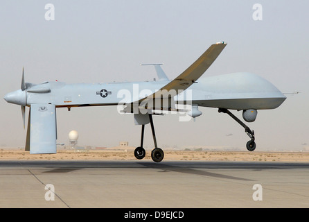 An MQ-1 Predator unmanned aircraft prepares for takeoff in support of operations in Southwest Asia. - Stock Photo