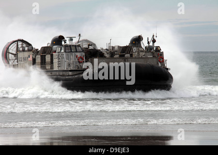 U.S. Navy Landing Craft Air Cushion makes a beach landing. - Stock Photo