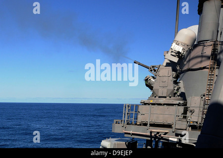 USS Monterey conducts a close-in weapons system live fire test. - Stock Photo