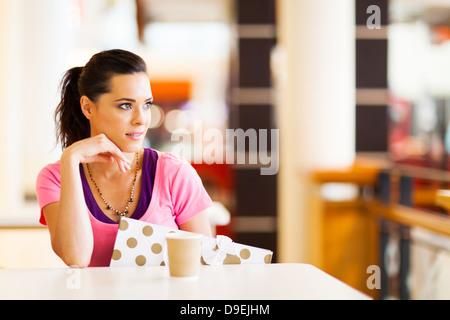 beautiful young woman resting in cafe after shopping - Stock Photo