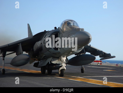 An AV-8B Harrier launches from the flight deck of USS Peleliu. - Stock Photo