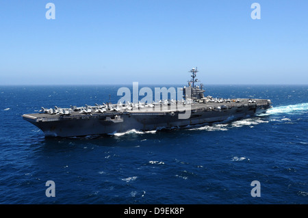 The Nimitz-class aircraft carrier USS John C. Stennis underway in the Pacific Ocean. - Stock Photo