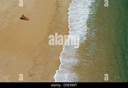 Lonesome solar adorer on a beach Algarve, Portugal. - Stock Photo