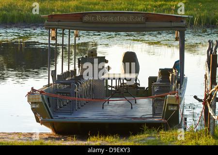 'Sir Rosis of the River' boat on banks of Thamalakane River, Okavango River Lodge, Maun, Okavango Delta, Botswana, - Stock Photo