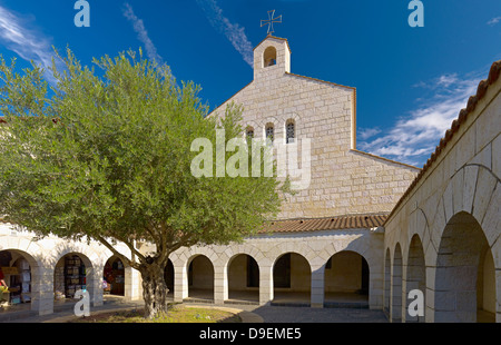 Courtyard of the Church of Multiplication in Tabgha on the main street Via Maris at Capernaum, Sea of Galilee, Israel - Stock Photo