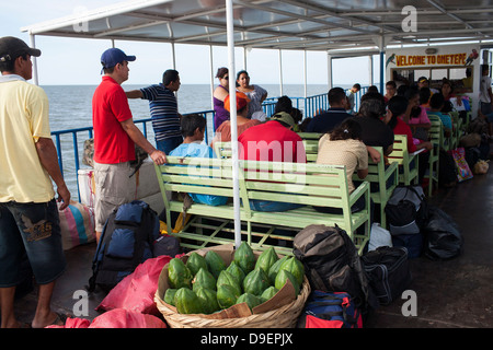 Passengers on the deck of the Rivas to Moyogalpa ferry on Ometepe in the middle of Lake Nicaragua - Stock Photo
