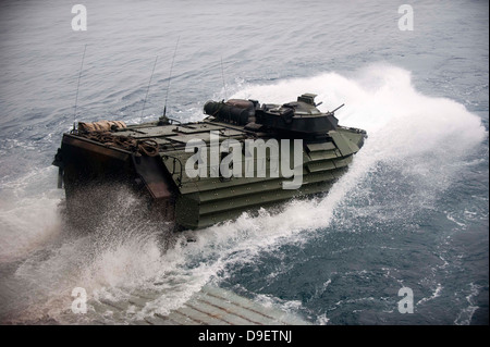 An amphibious assault vehicle departs the well deck of USS New Orleans. - Stock Photo