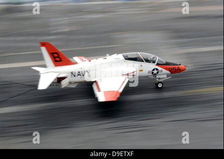 A T-45C Goshawk training aircraft makes an arrested landing. - Stock Photo