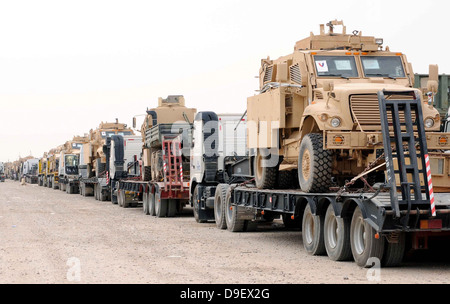 A convoy of Mine-Resistant Ambush Protected vehicles ready for departure - Stock Photo