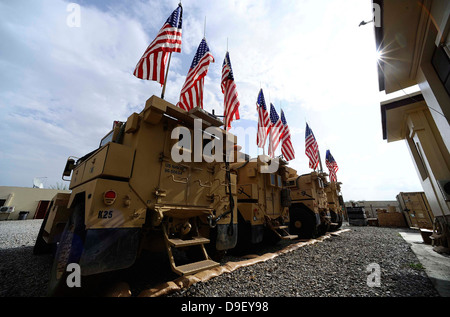 American flags are displayed on tactical vehicles in remembrance of 9/11. - Stock Photo