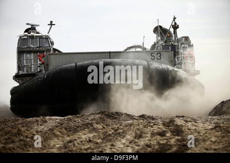 A landing craft, air cushion prepares to depart Onslow Beach. - Stock Photo