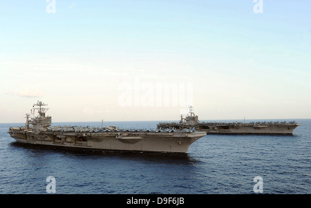 Nimitz-class aircraft carriers transit the Arabian Sea. - Stock Photo