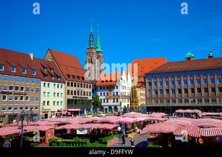 Schoener Brunnen Fountain, Market Square and St. Sebaldus Church, Nuremberg, Bavaria, Germany - Stock Photo