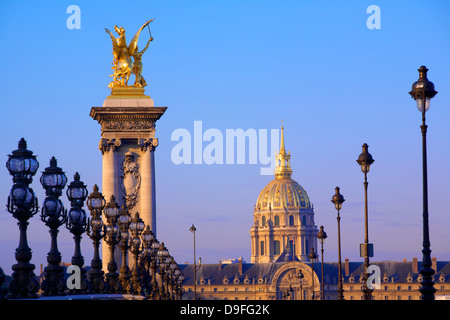 Pont Alexandre III with Chapel of Saint-Louis-des-Invalides in the background, Paris, France - Stock Photo