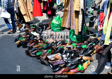 Second hand clothes and shoes for sale, Portobello Road market, London, UK. - Stock Photo