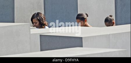 Berlin, Germany. 19th June, 2013. US first lady Michelle Obama (L) visits the Memorial to the Murdered Jews of Europe - Stock Photo