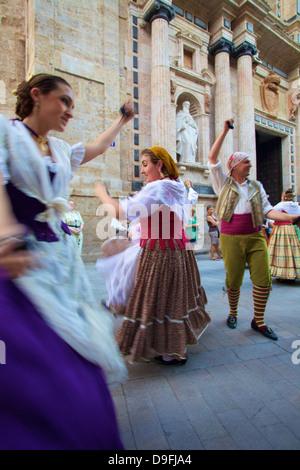 Traditional dancing outside the 13th century Iglesia y Convento Del Carmen, Valencia, Spain - Stock Photo