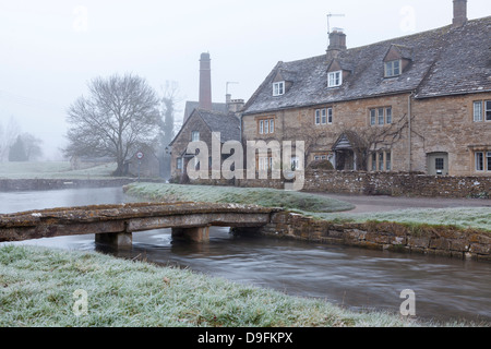 A misty and frosty winters morning, Lower Slaughter, Cotswolds, Gloucestershire, England, UK - Stock Photo