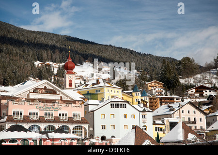 The town of Ortisei in the Dolomites near the Alpe di Siusi ski resort, South Tyrol, Italy - Stock Photo