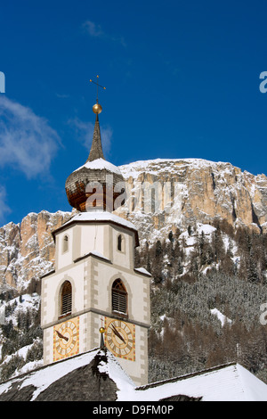 A church belltower in Colfosco in Badia in the Dolomites in the South Tyrol, Italy - Stock Photo