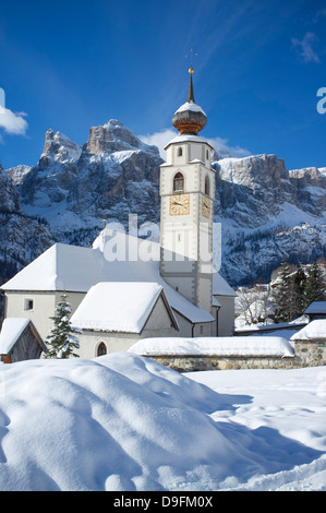 A church in Colfosco in Badia near the Sella Massif mountain range in the Dolomites, South Tyrol, Italy - Stock Photo