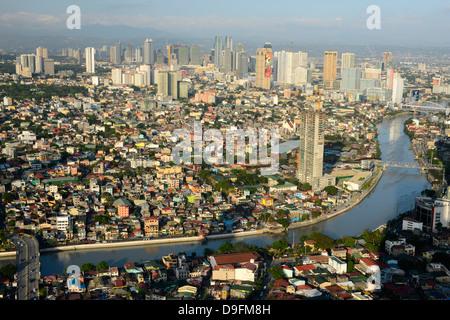 Tall buildings on Ortiga Avenue, Pasig River and Mandaluyong beyond, Metromanila, Philippines, Southeast Asia - Stock Photo