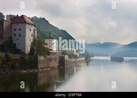 Cruise ship passing on the River Danube in the early morning mist, Passau, Bavaria, Germany - Stock Photo