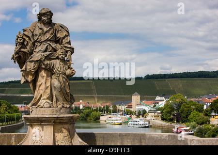 Statues on the old Main Bridge in Wurzburg, Franconia, Bavaria, Germany - Stock Photo