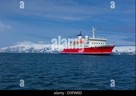 Cruise ship anchoring in the volcanic crater of Deception Island, South Shetland Islands, Antarctica, Polar Regions - Stock Photo