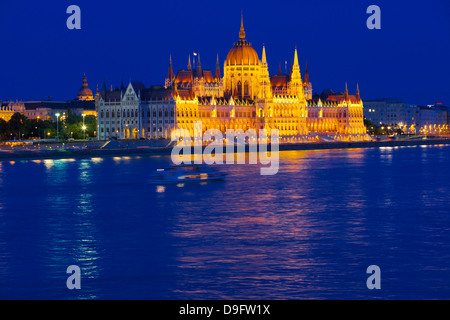 Parliament near the River Danube at night, Budapest, Hungary - Stock Photo