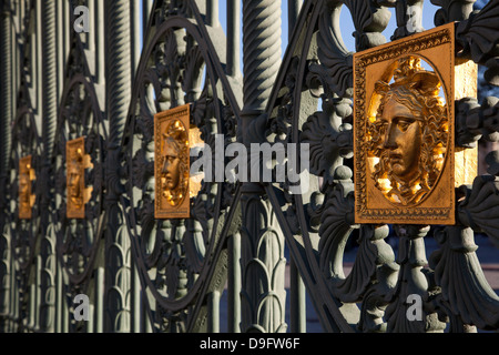 Gates of the Royal Palace of Turin (Palazzo Reale) embossed with a Medusa symbol to fend off intruders, Turin, Piedmont, - Stock Photo